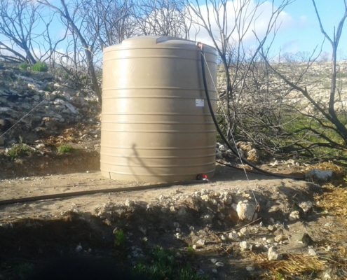First water tank in elevated position, and filled with spring water